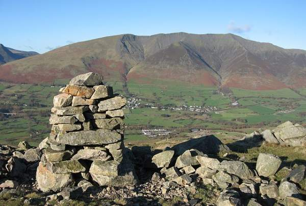 image of Blencathra and Threlkeld village from one of the cairns on Threlkeld Knotts