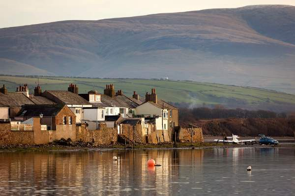 image of Ravenglass village houses beside the sea