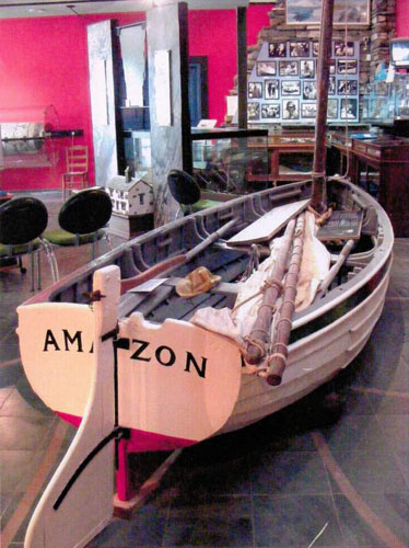 image of the sailing boat Mavis, inspiration for Amazon, inside the Ruskin Museum in Coniston in the Lake District