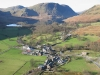 Looking from Buttermere village across Crummock Water to Melbreak  St James\' church (right), Fish Hotel (left), Bridge Hotel (centre), Syke Farm (foreground).