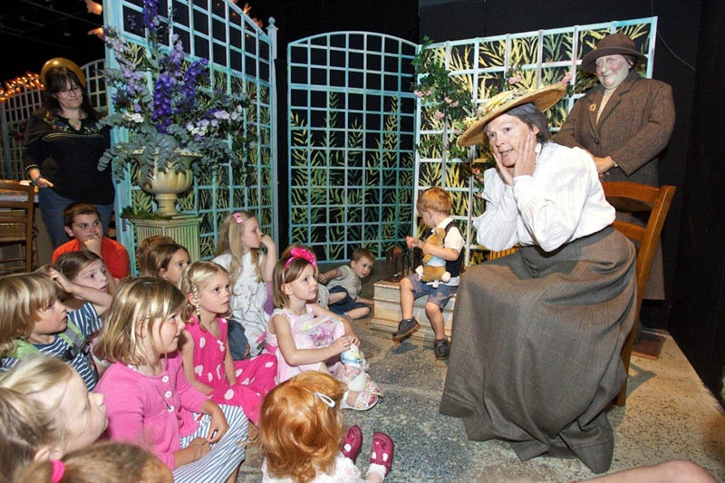 image of children listening to storytelling at the World of Beatrix Potter Attraction in the Lake District