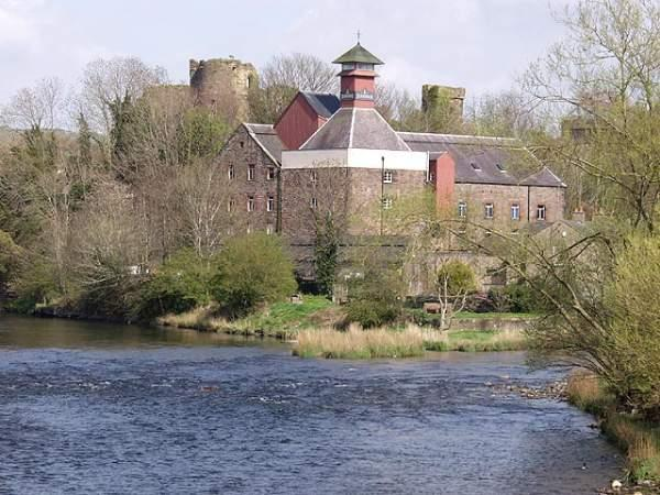 image of Jennings Brewery with the turrets of Cockermouth Castle behind and the confluence of the rivers Derwent and Cocker