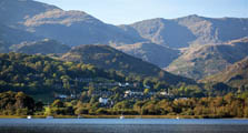 image of Coniston Water and Coniston Village in the South Lake District