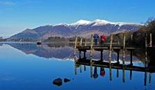an image of a jetty and skiddaw at derwentwater