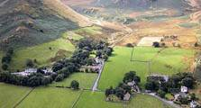 aerial image of farms at mungrisdale as an image link to the information page for mungrisdale hamlet