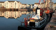 image of fishing boats at whitehaven harbour linking to the information page for whitehaven town