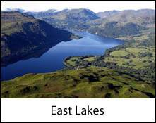 an aerial image of ullswater lake which is an image link to the information page for the east lakes area places to visit in the lake district