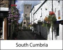 image of a street and flower baskets in kirkby lonsdale which is an image link to the information page for the south cumbria area places to visit in