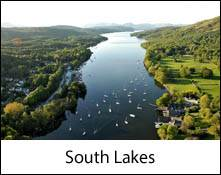 an aerial image of windermere lake which is an image link to the information page for the south lakes area places to visit in the lake district