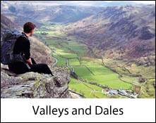 image of a boy sitting on a ledge looking over the borrowdale valley which is an image link to the valleys and dales places to visit in the lake district and cumbria page