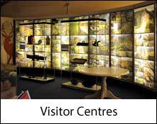 image of a tourist visitor centre indoor information display which is an image link to the visitor centres of the lake district page