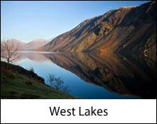 image of mountains reflected in wastwater lake which is an image link to the information page for the west lakes area places to visit in the lake district