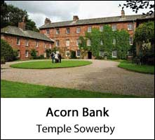 image of the front of acorn bank and a driveway at temple sowerby in cumbria
