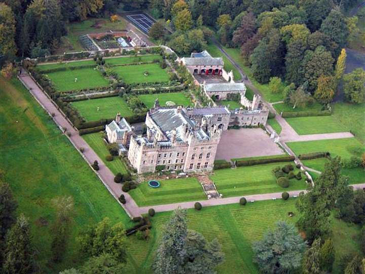 image of an aerial view of trees and grounds of hutton-in-the-forest historic house to visit in cumbria