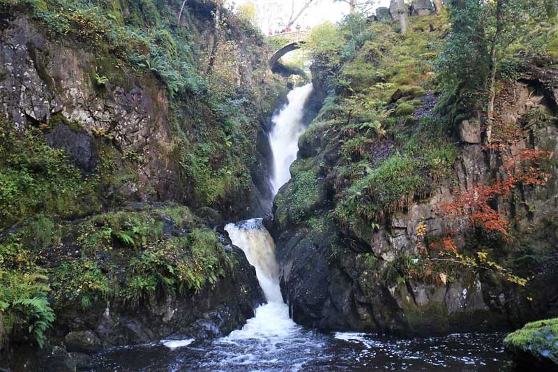 image of a waterfall and bridge at aira force in the lake district
