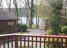 an image of lake district lodges set between the trees beside bassenthwaite lake at lakeside lodges holiday park at bassenthwaite in the lake district