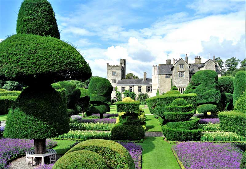 image of the facade of levens hall, kendal, and the topiary garden