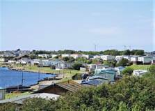 an image of holiday caravans beside the lake at port haverigg holiday park near millom in cumbria