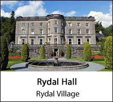 image of the front of rydal hall and its gardens under a blue sky at rydal village in the lake district page