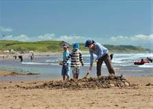 an image of a family playing on the beach near seacote holiday park at st bees