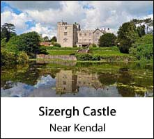 image of sizergh castle and reflections in a pond at kendal in england