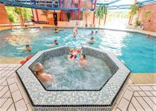 an image of the indoor swimming pool and jacuzzi at solway holiday village in cumbria