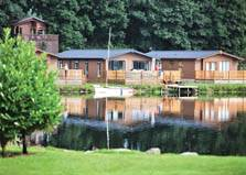 an image of lake district lodges on the side of windermere lake at South Lakeland Leisure Village