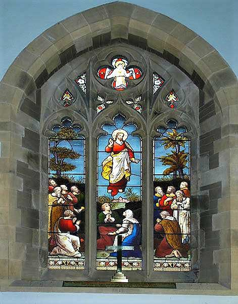 image of a stained glass window at st mary's church, rydal in the lake district