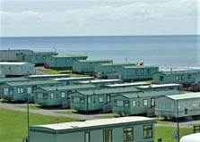 an image of caravans beside the sea at tarnside holiday park in cumbria