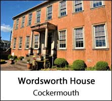 image of the terracotta facade of wordsworth house in cockermouth cumbria