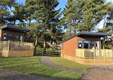 an image of lake district lodges on a holiday park at ullswater in cumbria