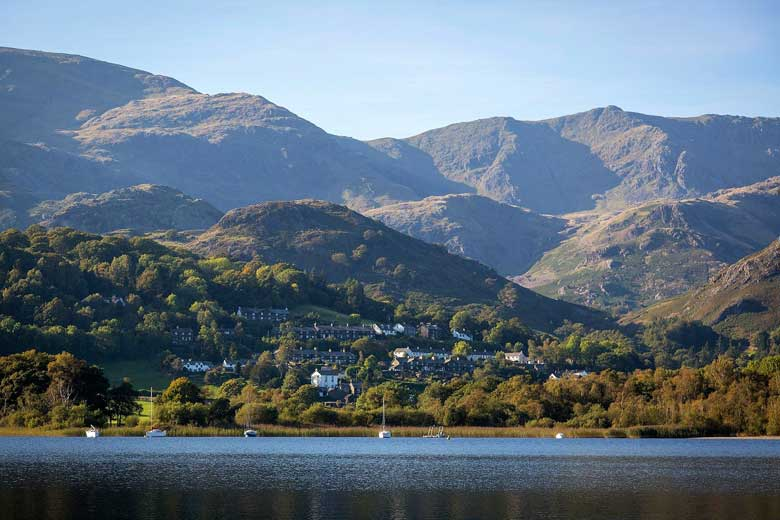 image of coniston village viewed from Coniston Water
