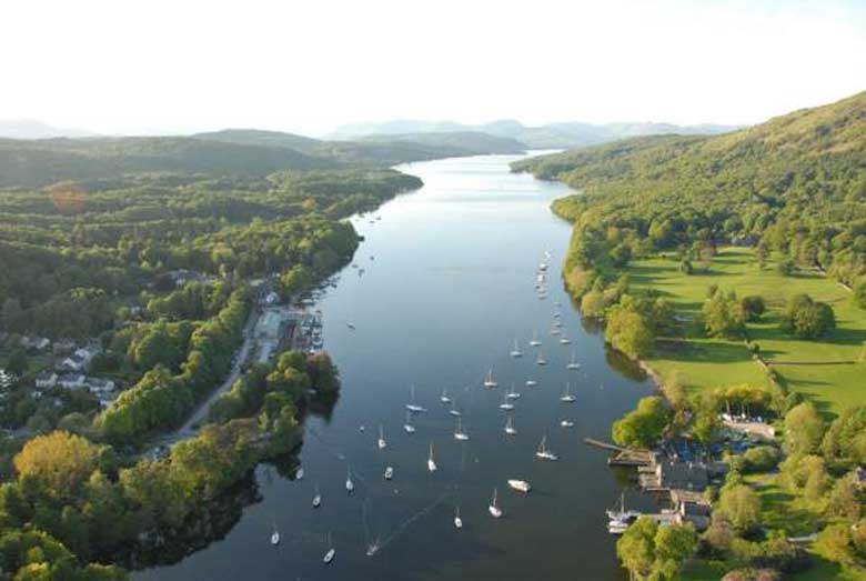 an image of an aerial view of windermere lake in the south lakes area of the English lake district, taken from a balloon and looking north from the foot of the lake