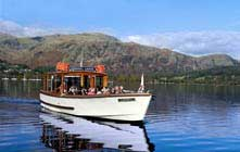 image of a coniston launch on coniston water in the lake district