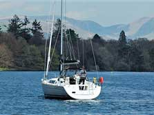 image of a yacht on Windermere lake for sailing activities