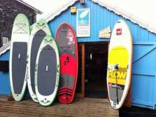 image of canoes, kayaks and stand up paddleboards for windermere activities on the water