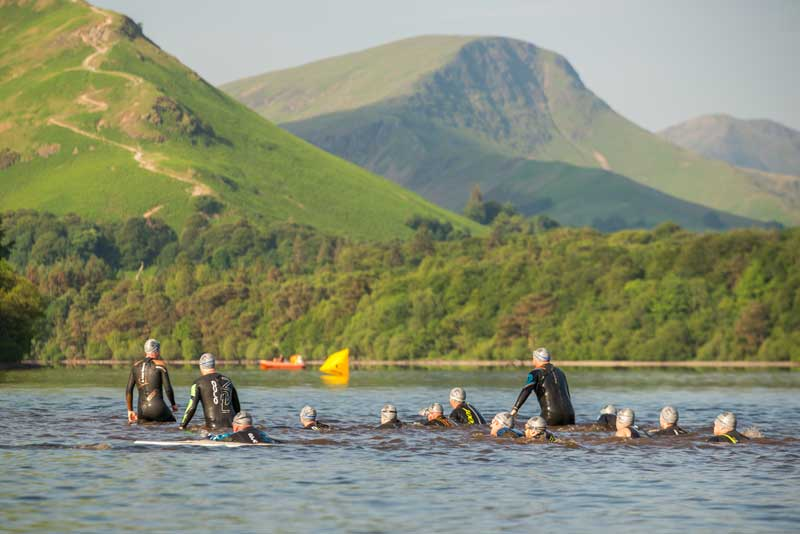 image of swimmers in Derwentwater participating in the Keswick Mountain Festival near Keswick in the Lake District
