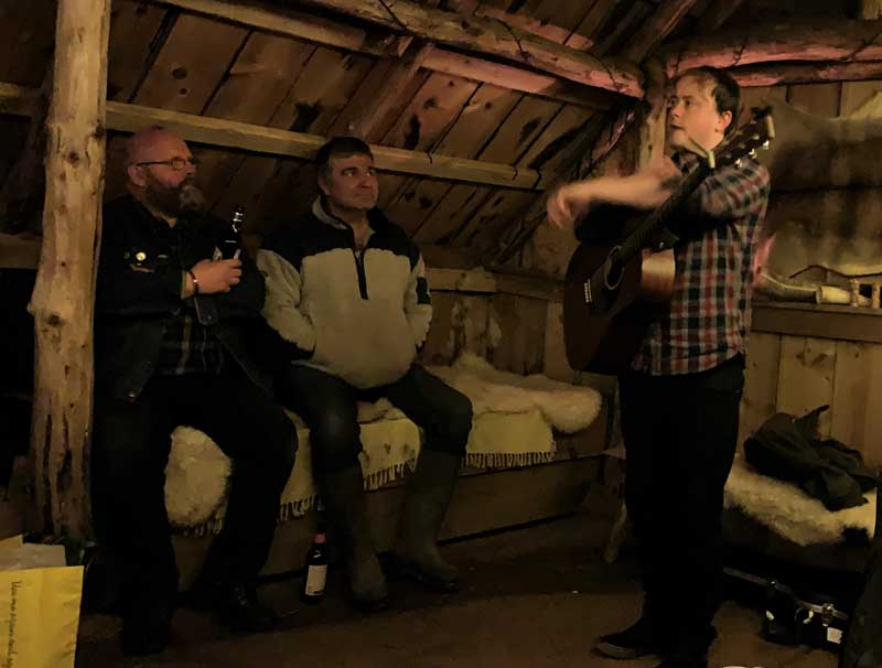 image of the live folk night in the Viking longhouse at Moorforge Viking Settlement in Cumbria