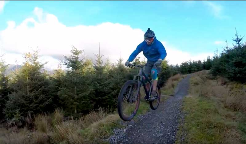 image of a rider on the Whinlatter Altura downhill mountain biking track