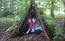 image of children in a den at Bushcraft Days at Whinlatter
