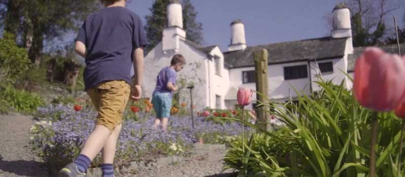 image of children playing in the garden at Townend summer trail event in the Lake District