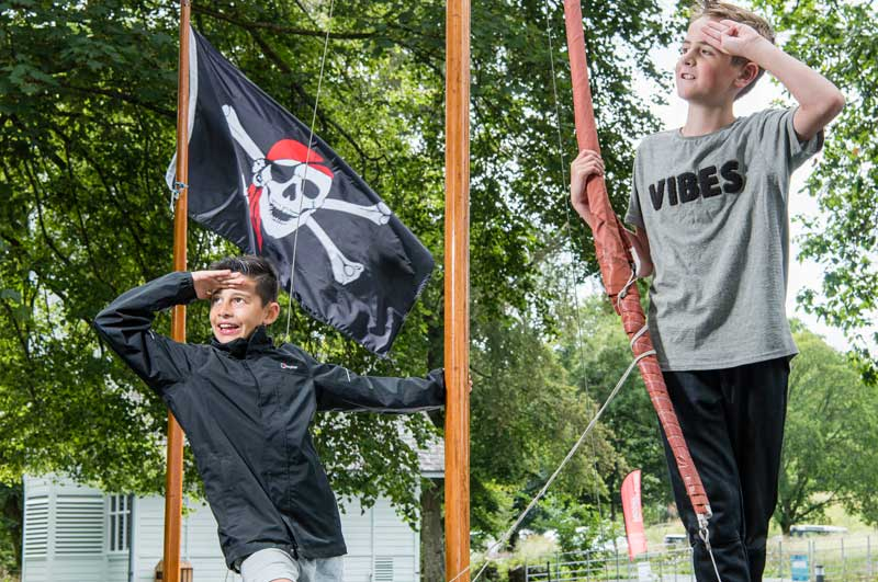 image of children playing on a pirate ship at Lake District event at Windermere Jetty Museum of Boats, Steam and Stories