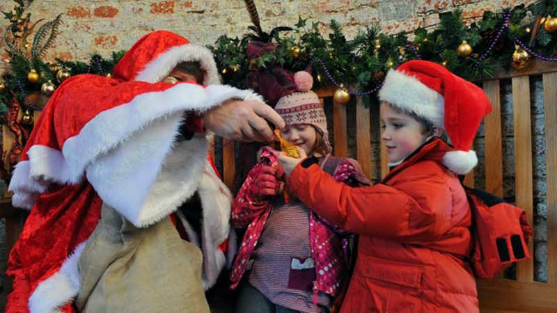 image of father christmas at a lake district event in sizergh castle