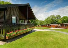 an image of wooden holiday cabins with saunas at woodlands hotel and lake district lodges at grange over sands in the lake district, cumbria