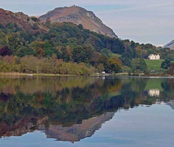 image looking across Grasmere to Helm Crag (Lion and Lamb) and Allan Bank.