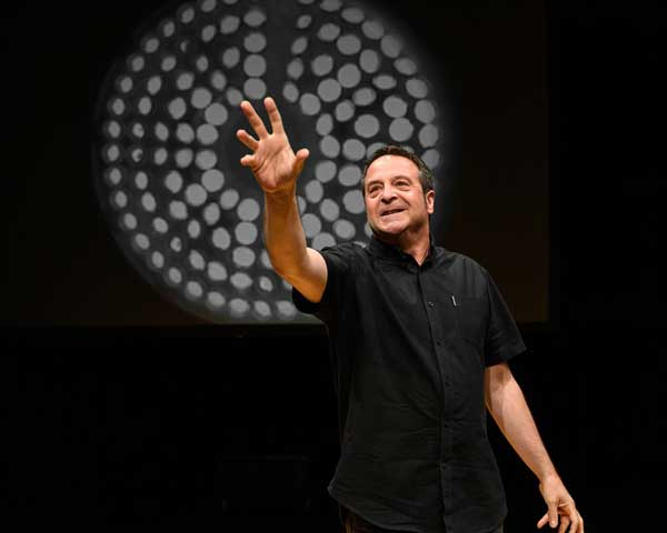 image of Mark Thomas in his stand up event in the Lake District