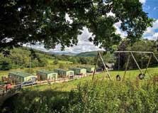 an image of holiday caravans and hills at Parkgate Farm holiday park in the Lake District