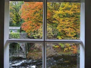 image of the river Greta and a bridge through the window of a romantic Lake District holiday cottage for two