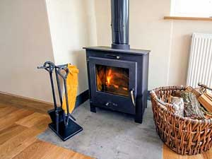 image of the woodburner in a Coniston self catering holiday apartment with hot tub