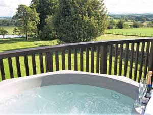 image of the hot tub on a balcony at Monkhouse Hill Lake District Cottages with Hot Tubs